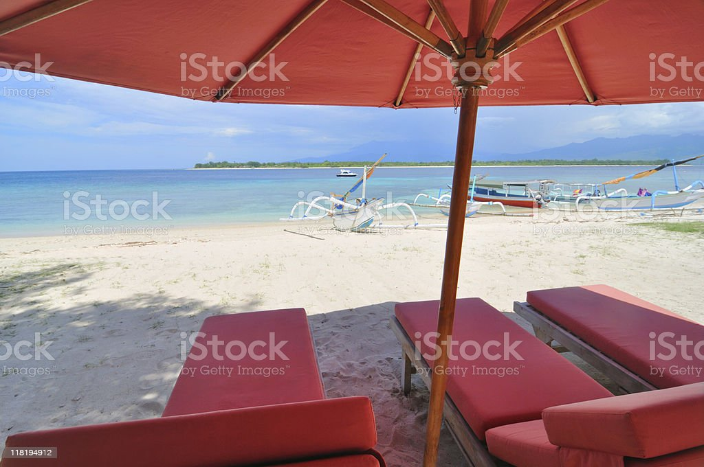 sunbath chairs and parasol royalty-free stock photo