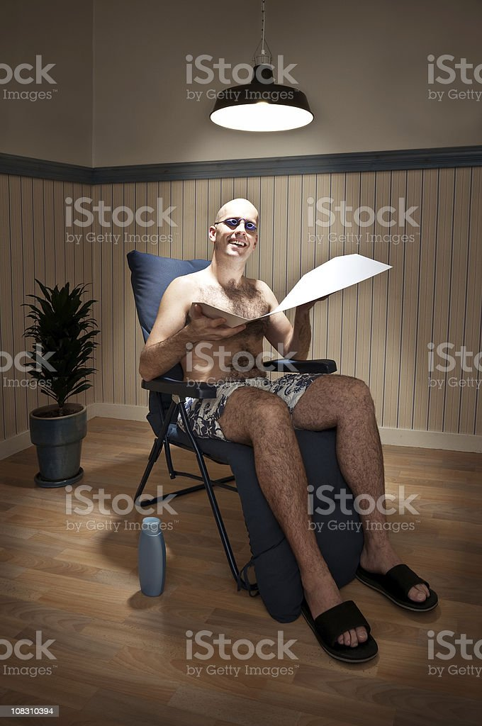 Sunbather in Solarium stock photo