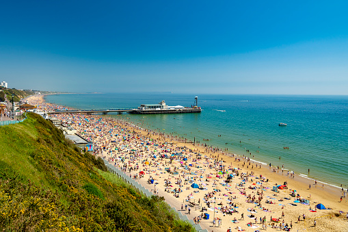 Sunbathers pack Bournemouth beach near the Pier