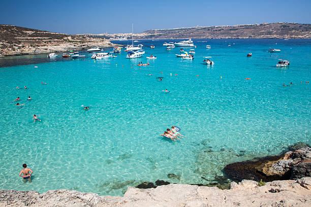 Sunbathing at blue lagoon - Comino, Malta stock photo