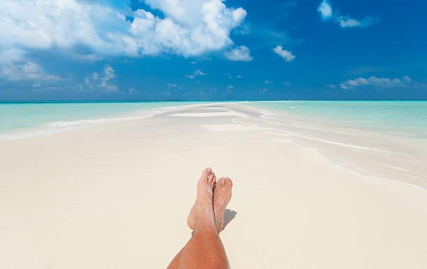 sunbathing at the beach stock photo