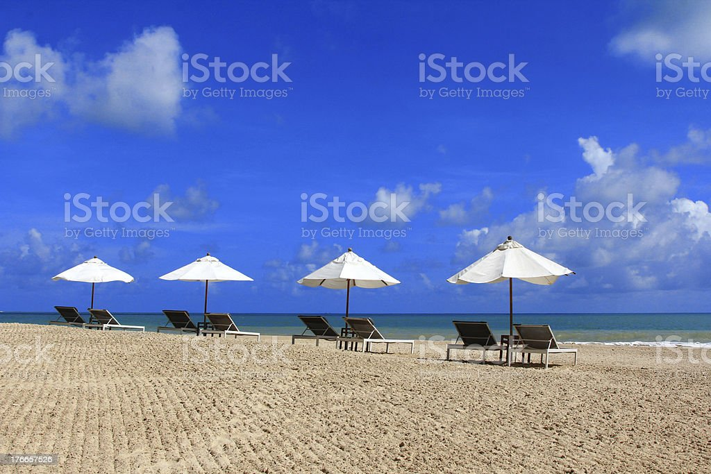 Sunbathing Beds with White Umbrella royalty-free stock photo