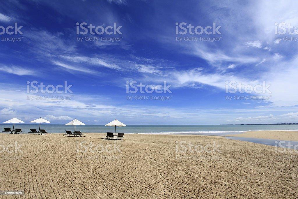 Sunbathing Beds with White Umbrella royalty-free stock photo