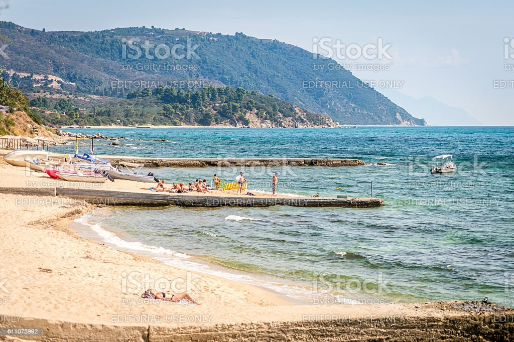Sunbathing on the beach in Ouranoupoli, Greece stock photo