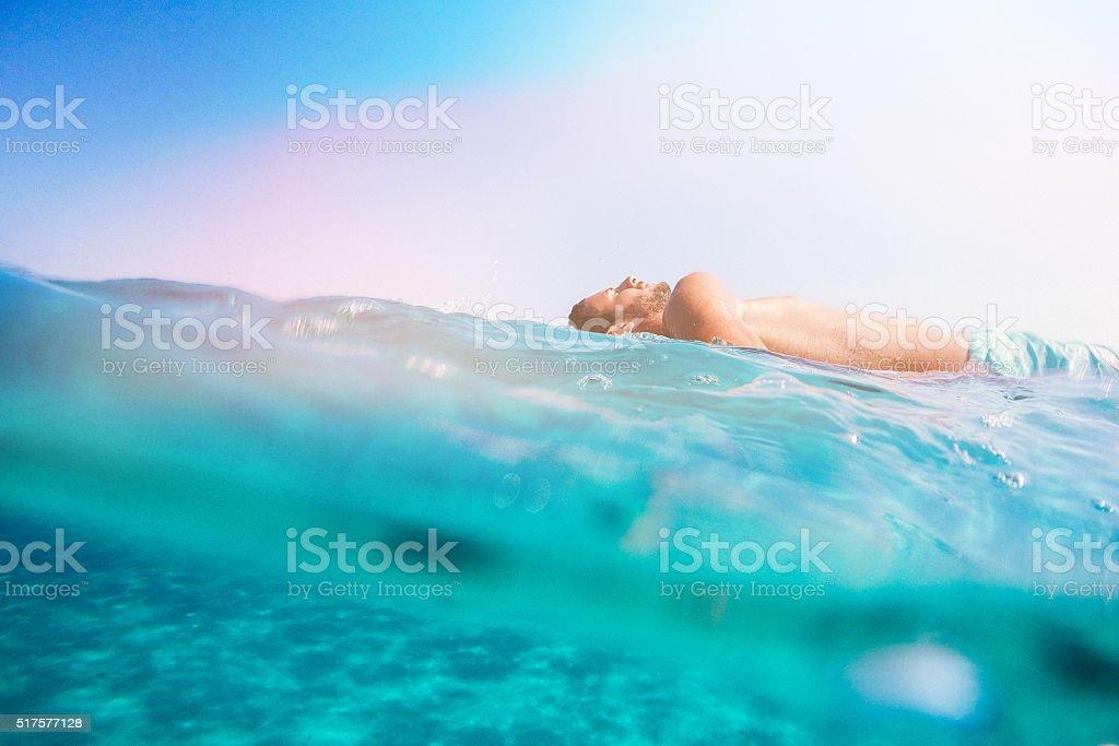 Sunbathing on the surfboard stock photo