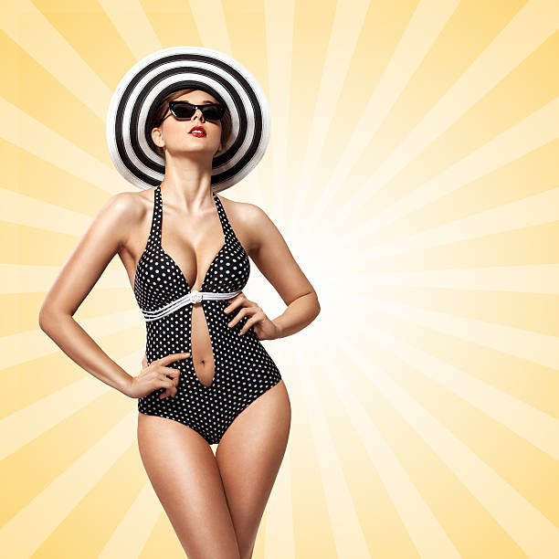 sunbathing. - pin up girl stock pictures, royalty-free photos & images
