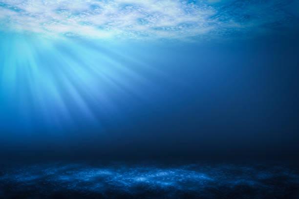 sunbeam abstract underwater backgrounds in the sea. - fondale marino foto e immagini stock