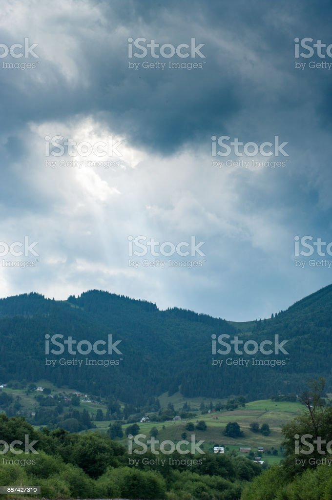 Sunbeam from the skies in mountains stock photo