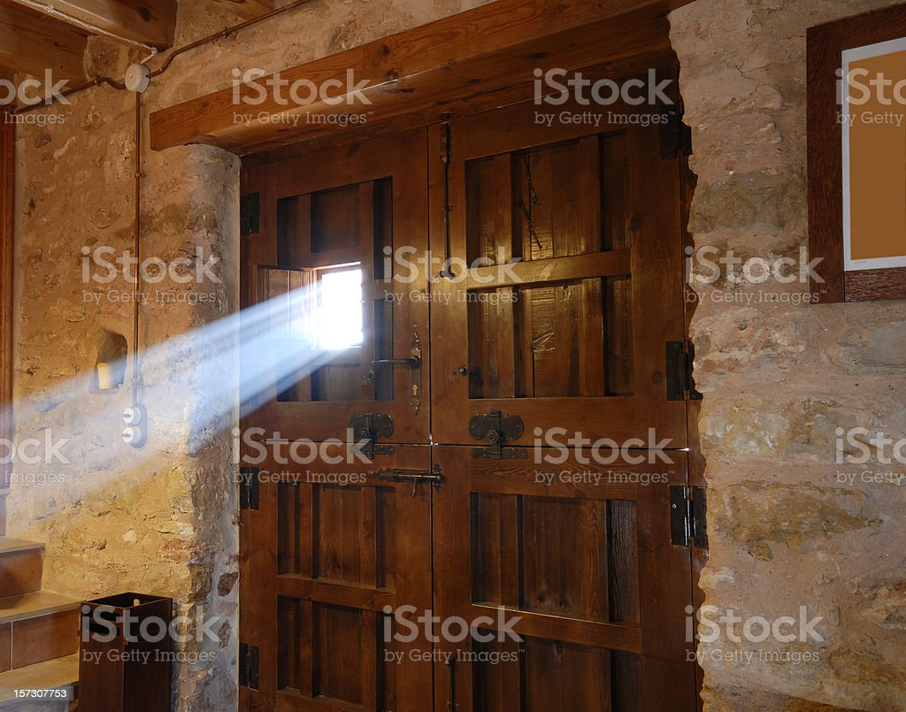 Sunbeam passing through a door window royalty-free stock photo