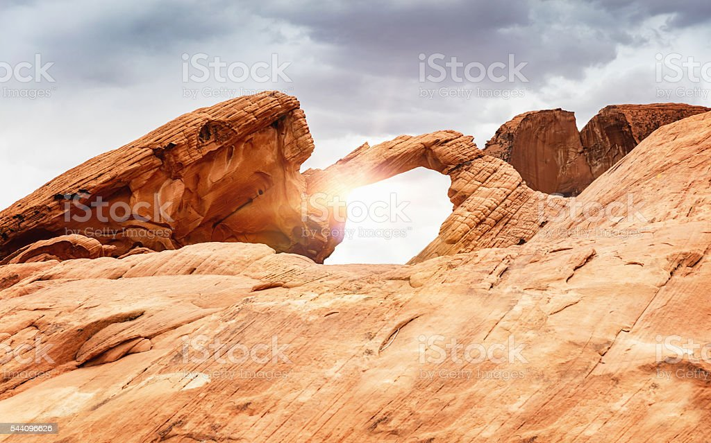 Sunbeam through Arch Rock Valley of Fire Nevada stock photo