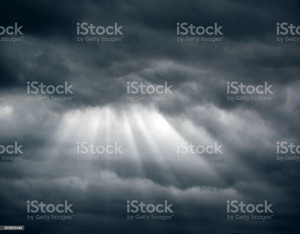 Sunbeam through cloudscape stock photo
