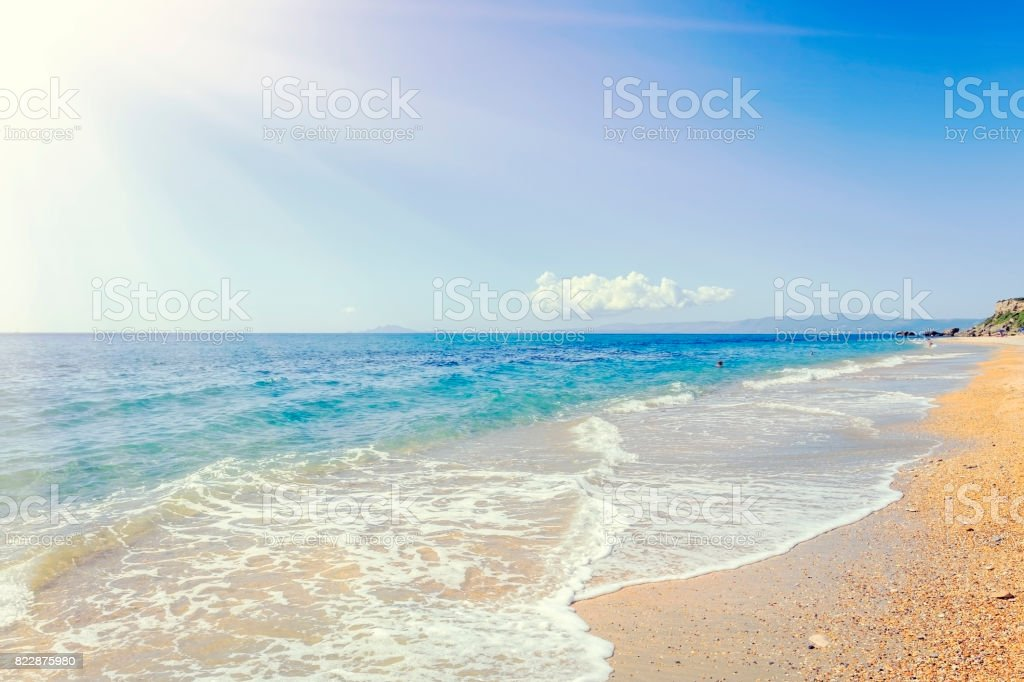 Sunbeams above the pebble beach at Skala, Kefalonia stock photo