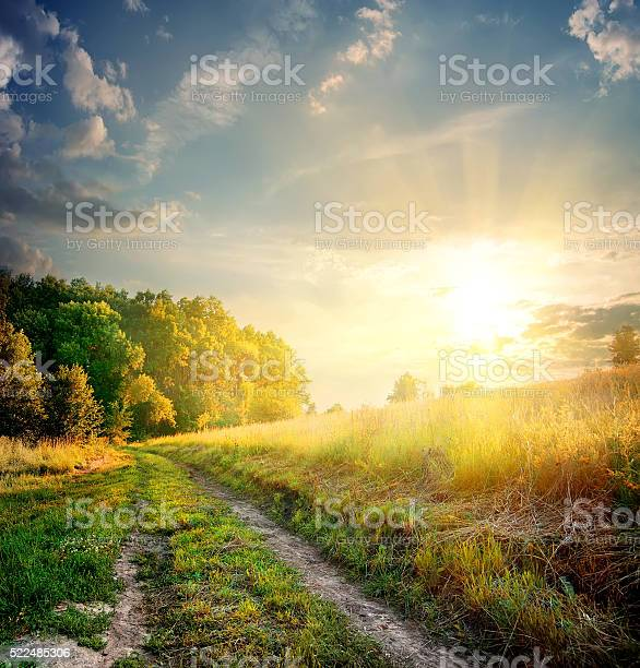 Photo of Sunbeams and country road