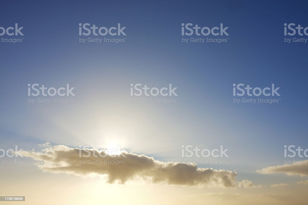 Sunbeams behind clouds royalty-free stock photo