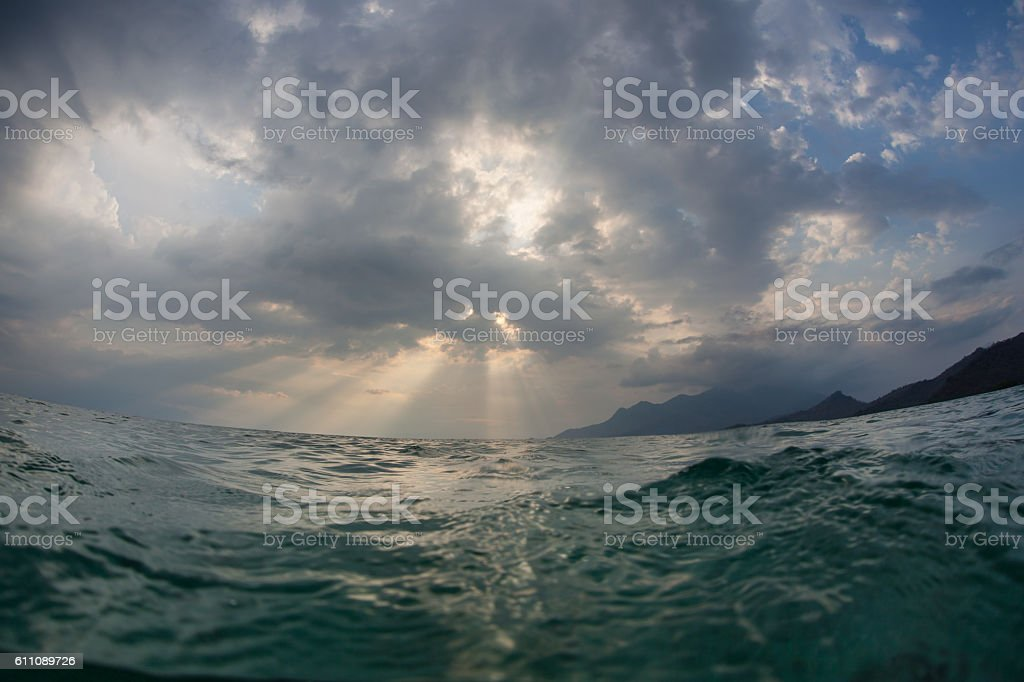 Sunbeams, Clouds, and Tropical Islands stock photo