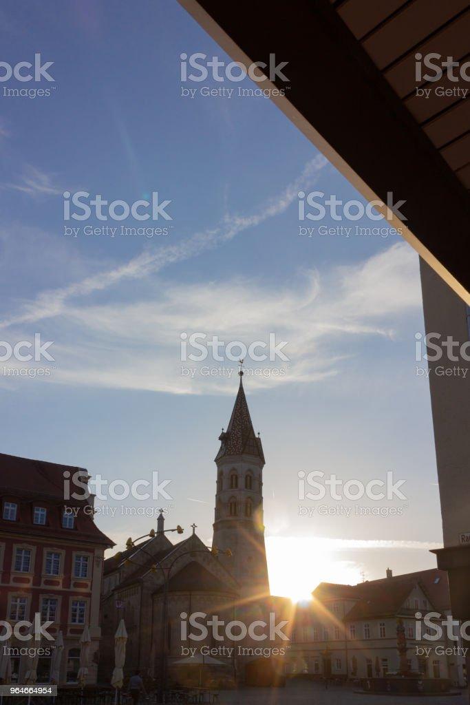 sunbeams near church at marketplace royalty-free stock photo