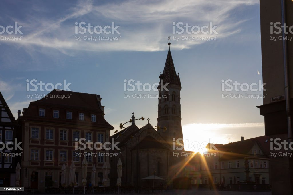 sunbeams near church at marketplace royalty-free stock photo