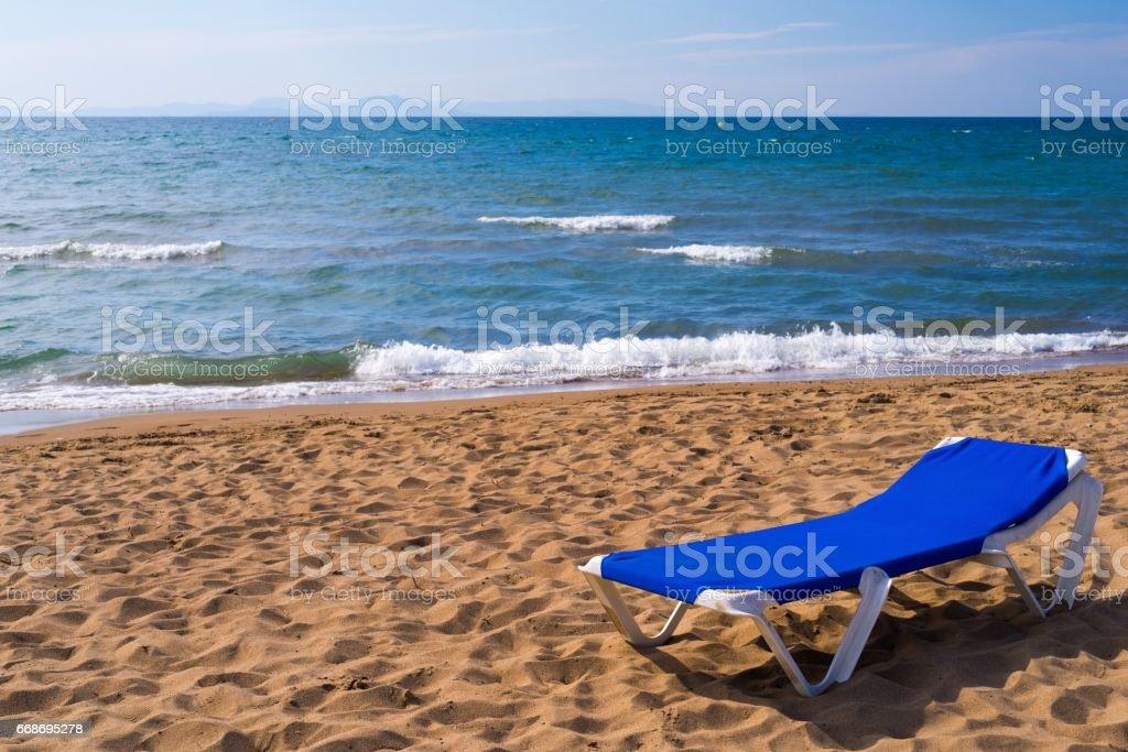 sunbed for suntan on the sandy coast stock photo