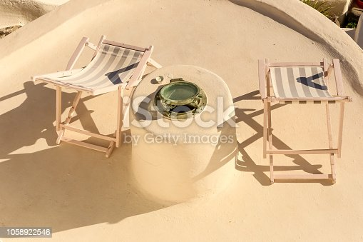 istock Sunbed On Terrace White Architecture. Summer vacation background 1058922546
