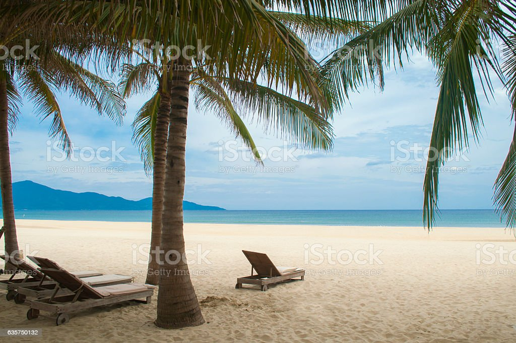 Sunbeds and palms in the My Khe beach, Danang, Vietnam stock photo