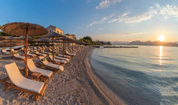 Sunbeds and umbrella on the beach, Corfu
