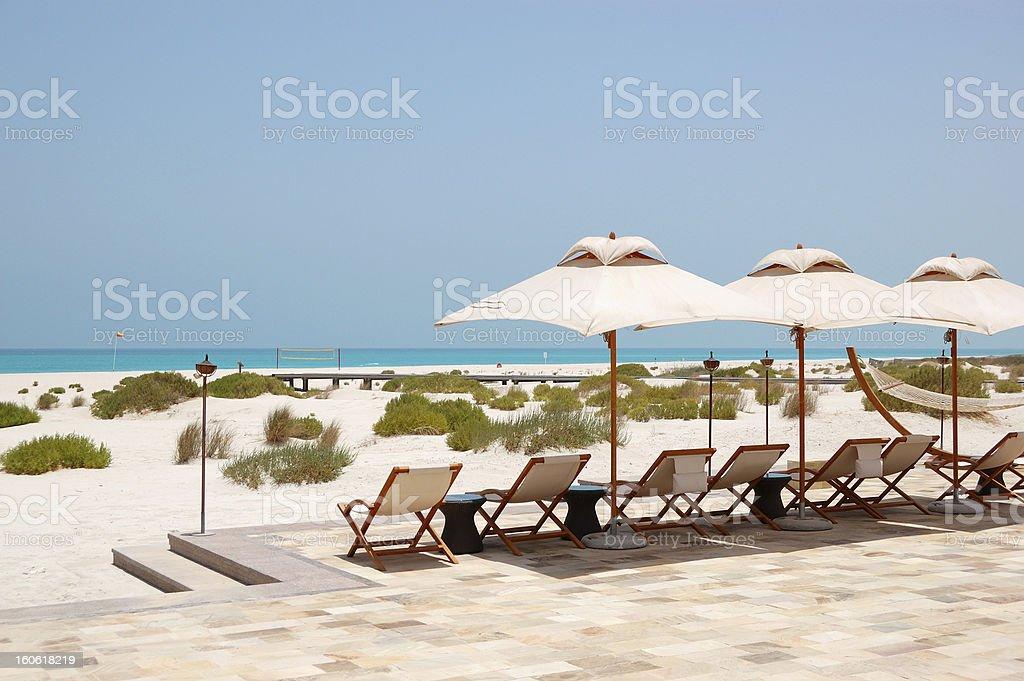 Sunbeds and umbrellas at beach, Abu Dhabi, UAE stock photo