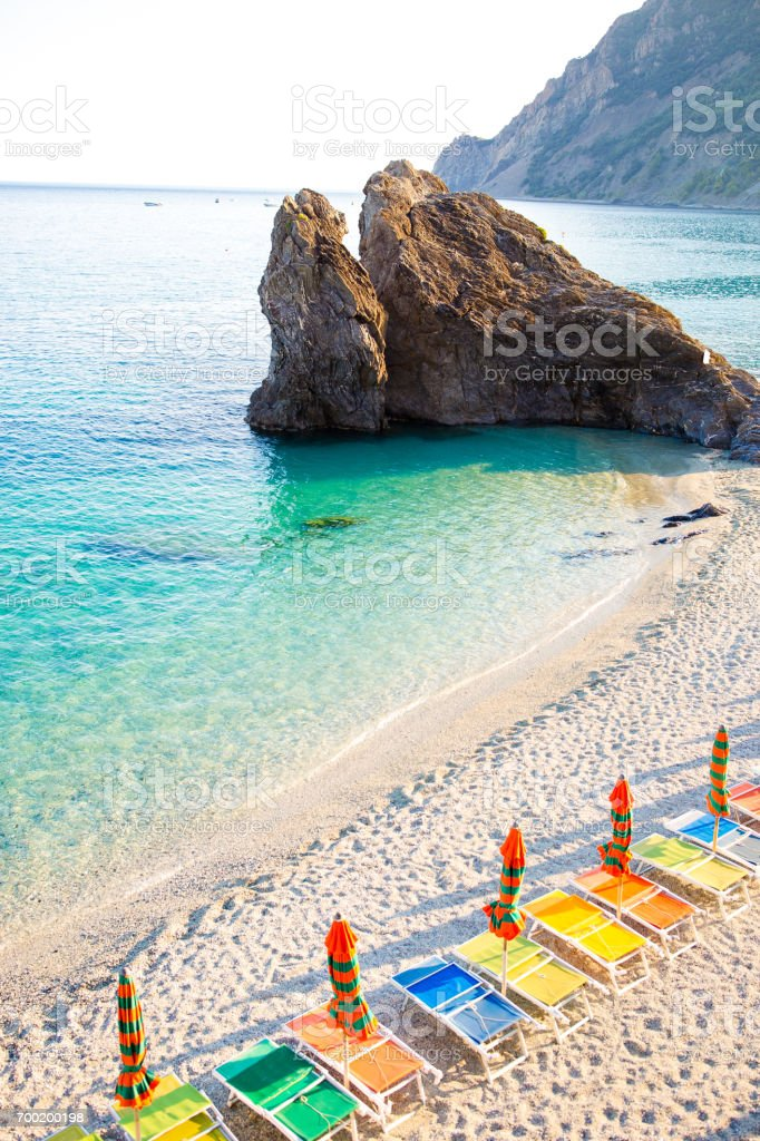 Sunbeds and umbrellas at beautiful european seashore in Monterosso in Italy - foto stock