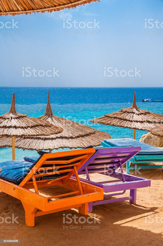 Sunbeds in a shadow stock photo