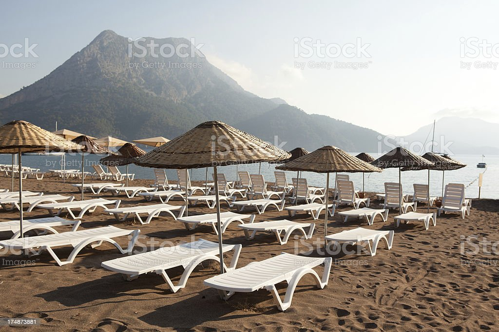 Sunbeds on Andarasn Beach, Antalya royalty-free stock photo