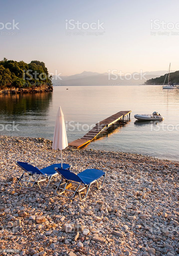 Sunbeds on Beach stock photo