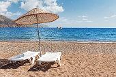 Sunbeds on sandy beach in Turkey