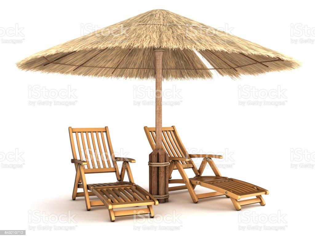 Sunbeds under an umbrella made of reeds. stock photo