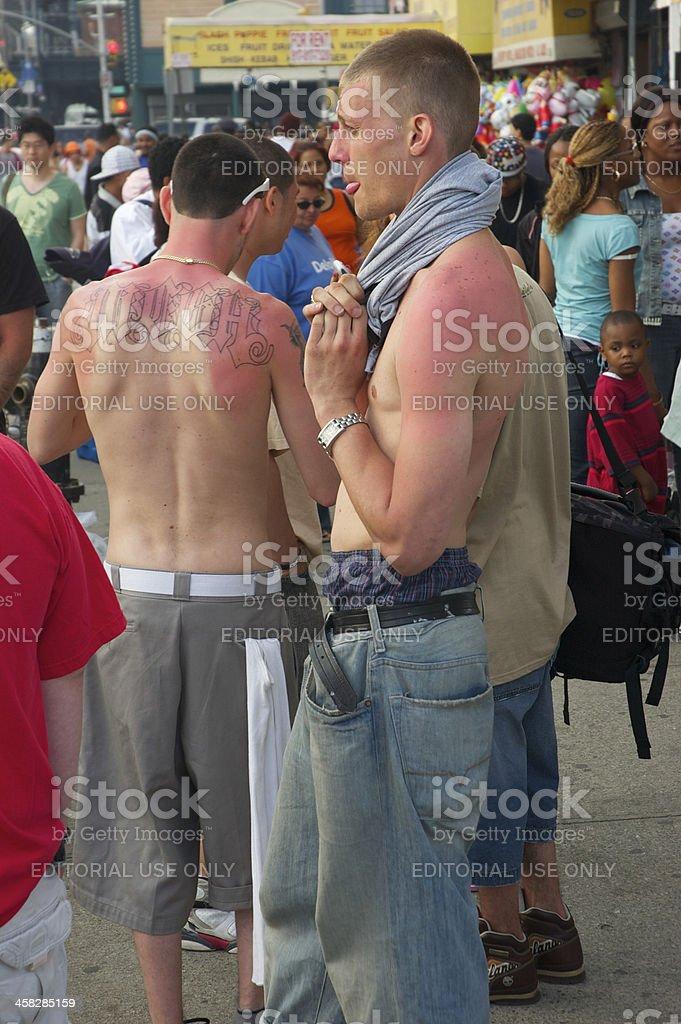 Sunburned Visitors Crowd Coney Island Boardwalk Brooklyn New York City royalty-free stock photo