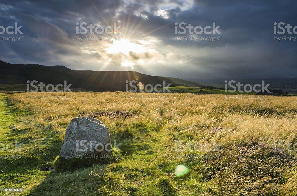 Sunburst above Simonside stock photo