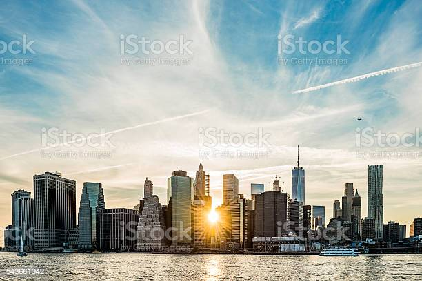 Photo of Sunburst between buildings of the Manhattan skyline in NYC