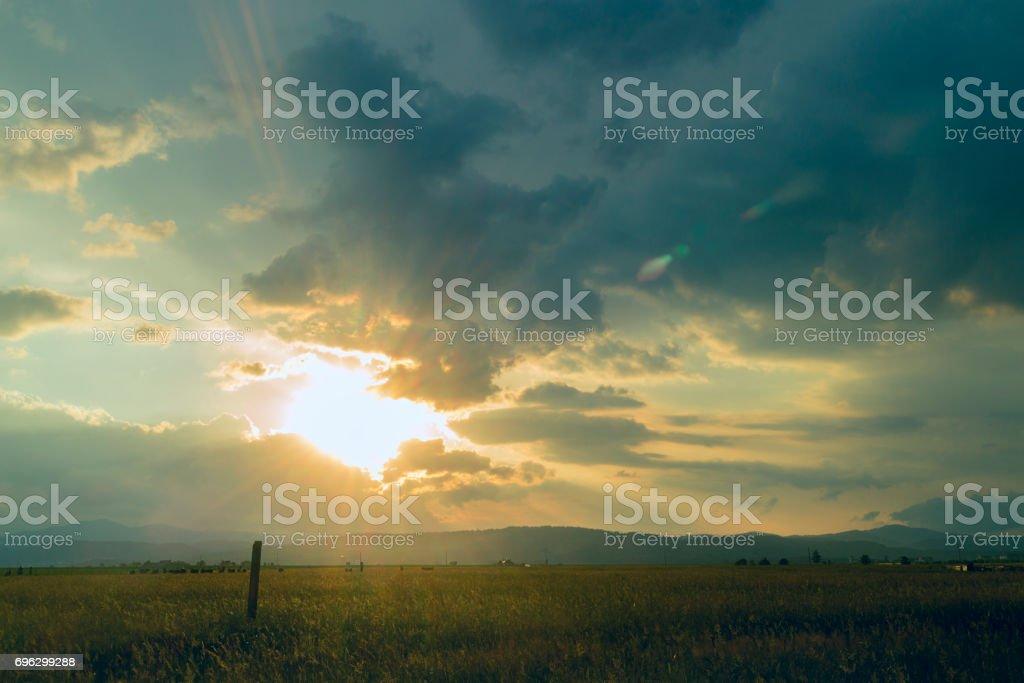 Sunburst over Rasnov Romania stock photo