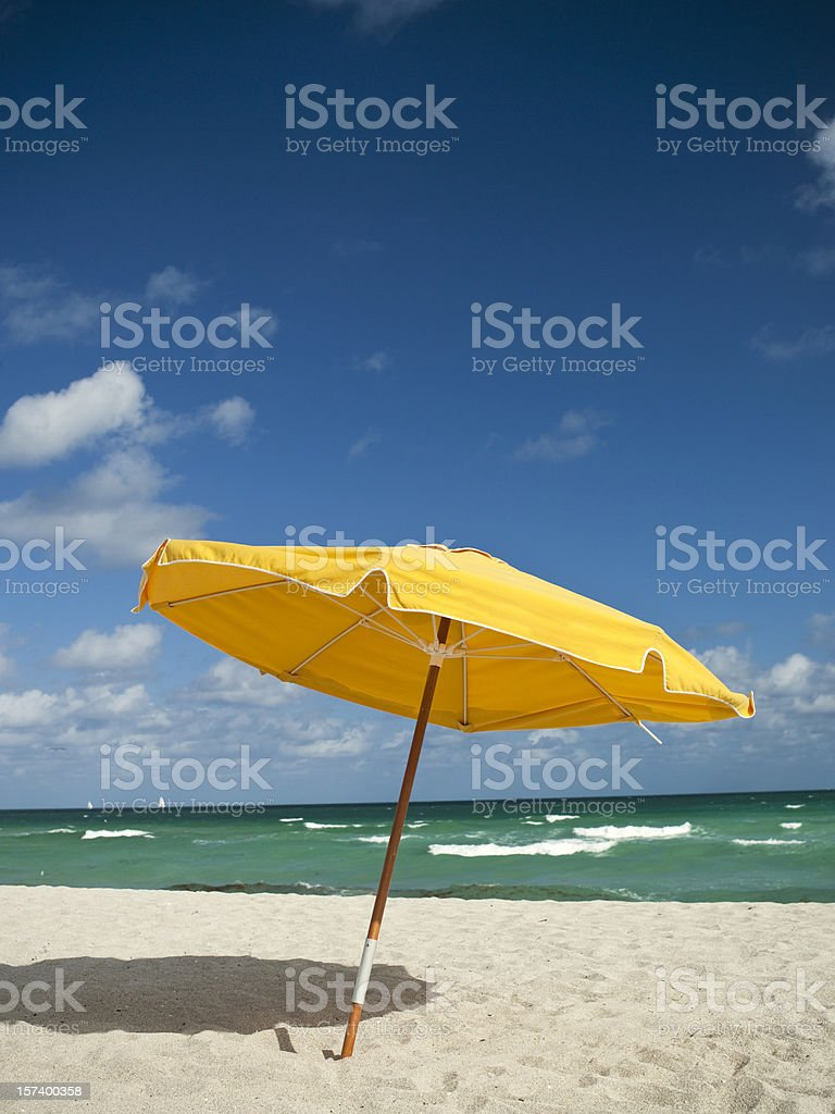 Sunchairs and umbrella on Beach royalty-free stock photo