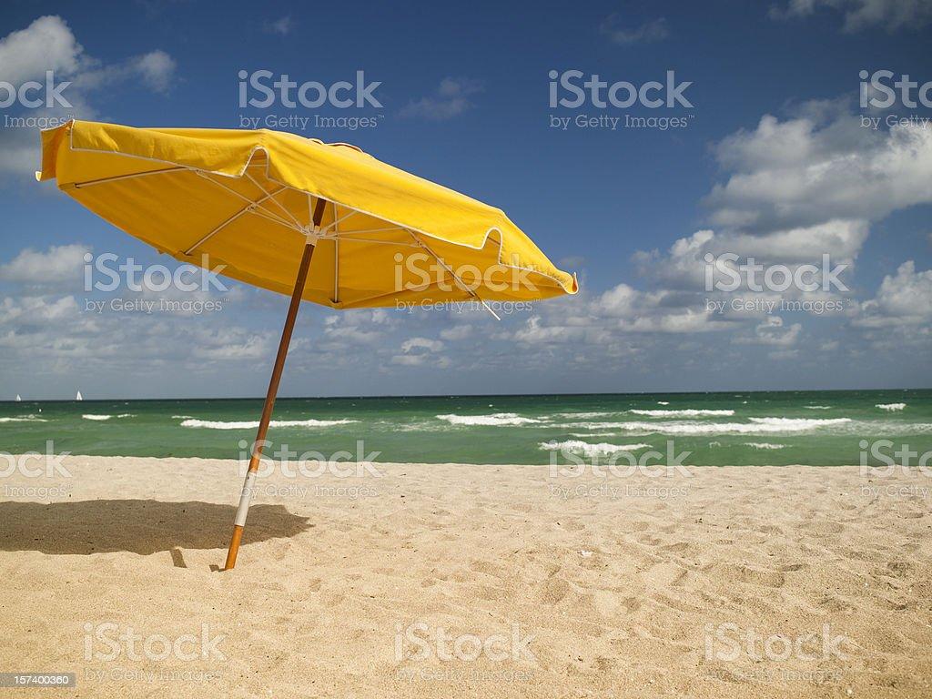 Sunchairs and umbrella on Beach royalty-free stock photo