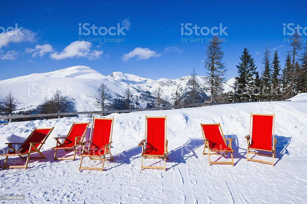 Sunchairs on ski resort royalty-free stock photo