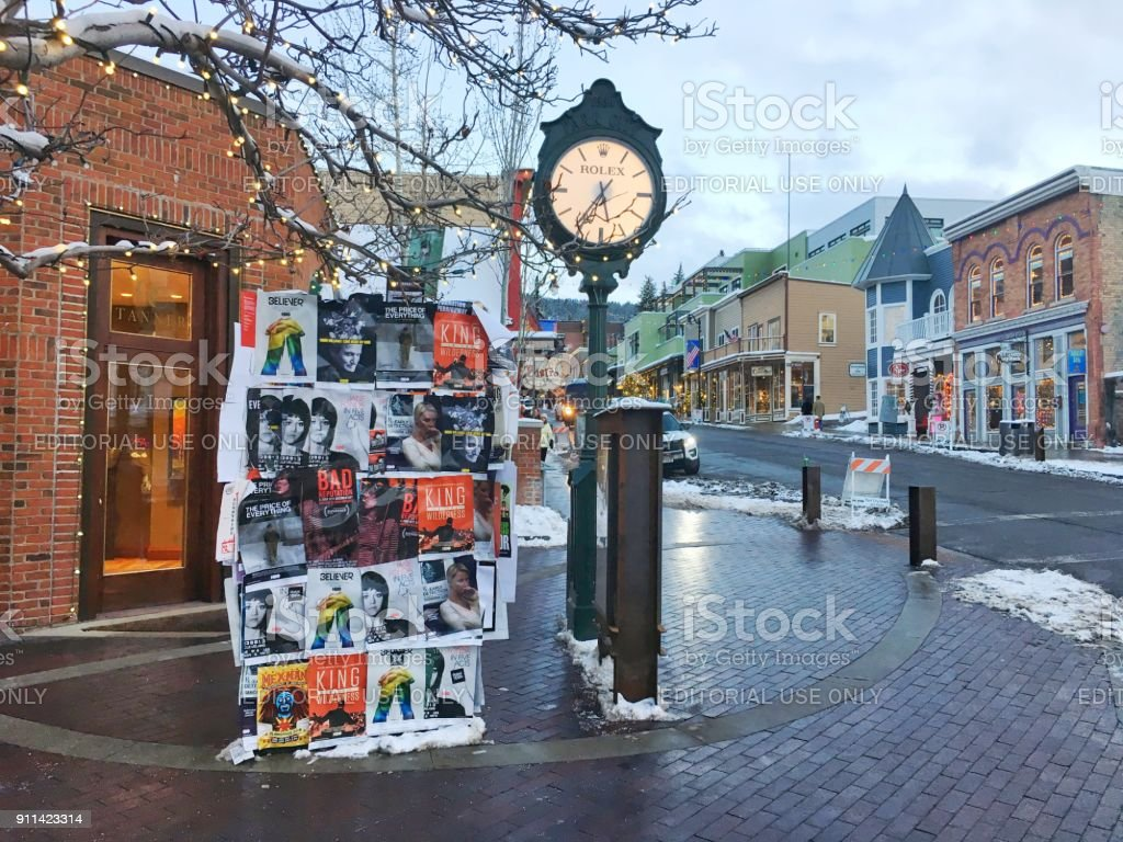 Sundance movie posters next to clock on Main Street in park city...