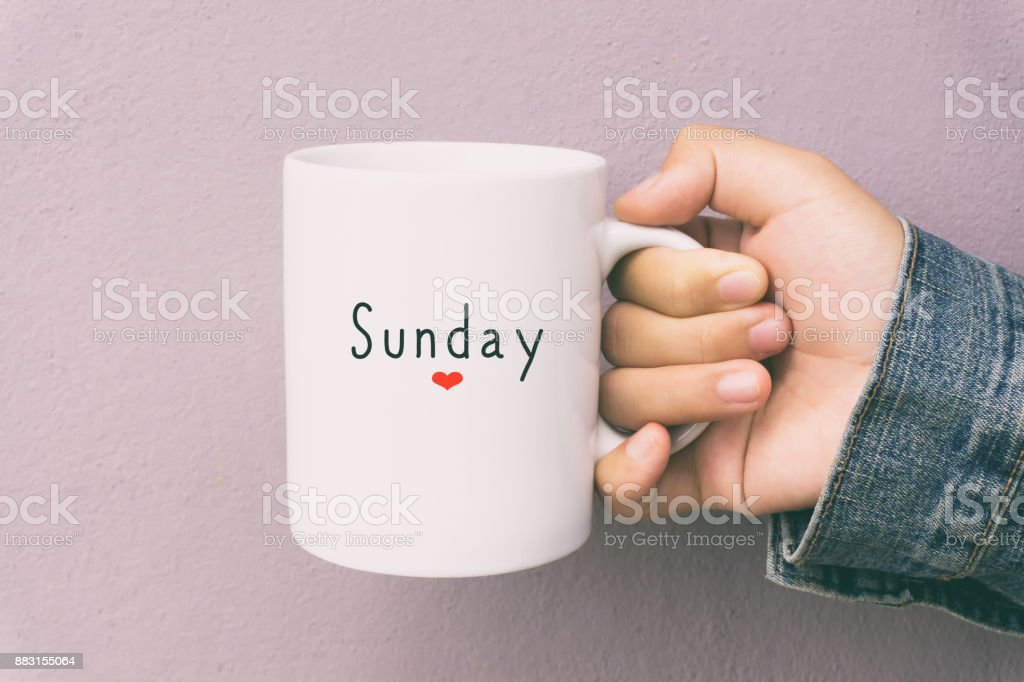 Sunday and Coffee - Woman Holding a Cup of Coffee stock photo