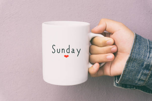 Sunday and Coffee - Woman Holding a Cup of Coffee Woman Hand Holding a Cup of Coffee With Text Sunday. sunday stock pictures, royalty-free photos & images