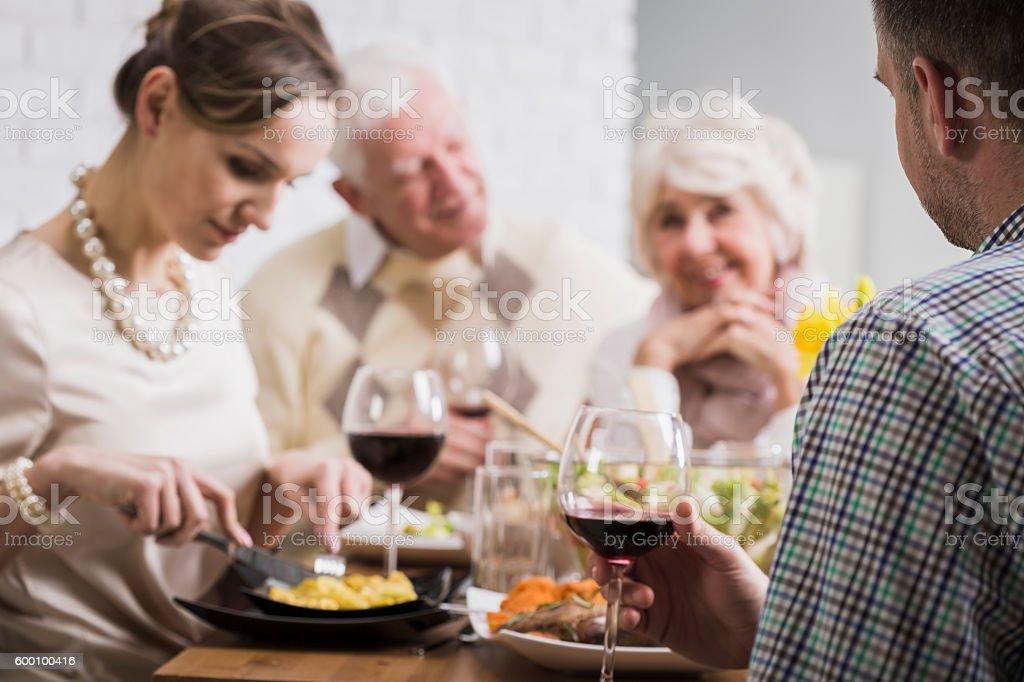 Sunday dinner with happy family stock photo