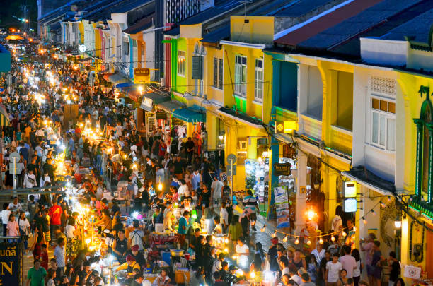 sunday evening street food market at thalang road in phuket old town - phuket stock photos and pictures