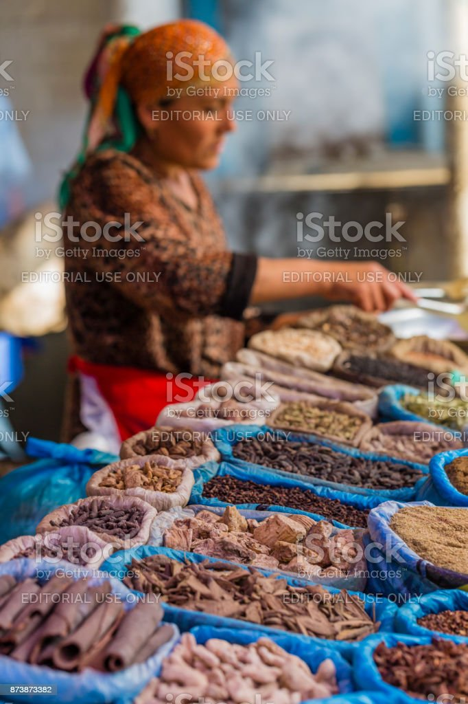 Bishkek, Kyrgyzstan - September 24, 2015:Sunday local food market and vivid oriental central asian market with bags full of various spices in Osh bazar in Bishkek, Kyrgyzstan. stock photo