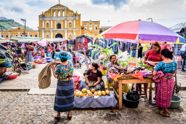 Sunday market in town plaza, Santa Maria de Jesus, Guatemala Santa Maria de Jesus, Guatemala - August 20, 2017: Colorful Sunday market in front of church in small indigenous town on slopes of Agua volcano near UNESCO World Heritage Site of Antigua. central america stock pictures, royalty-free photos & images