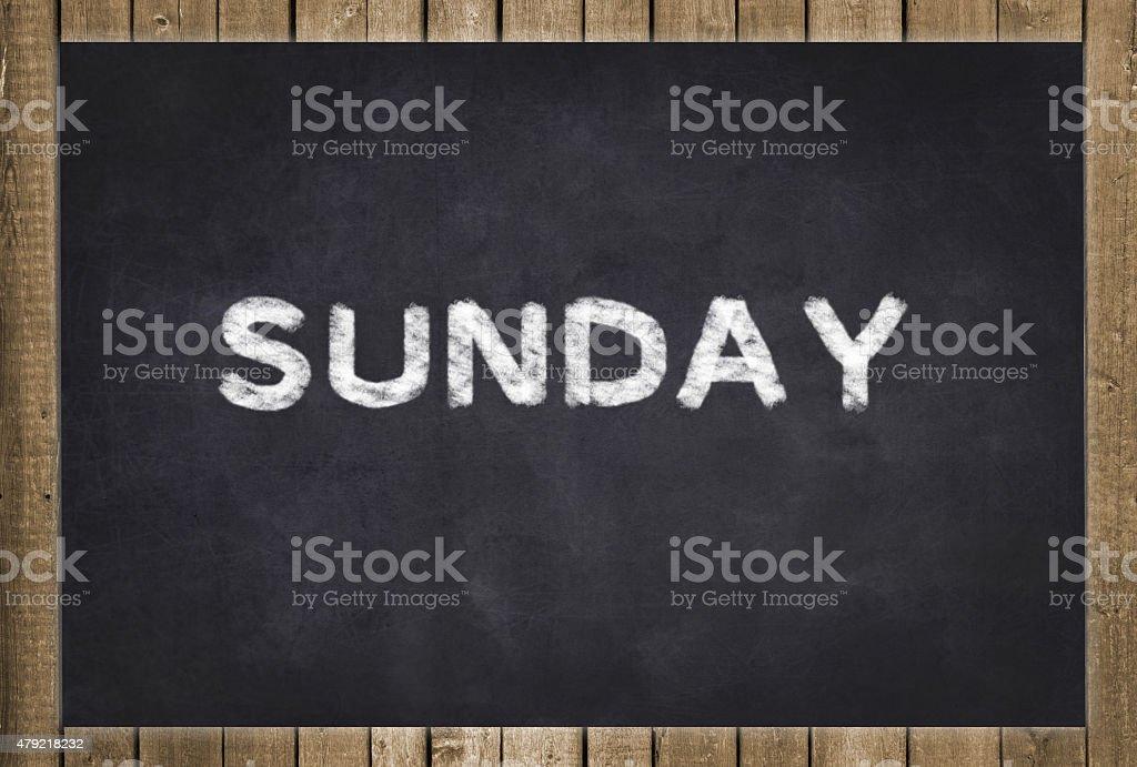 sunday- white text on chalkboard stock photo