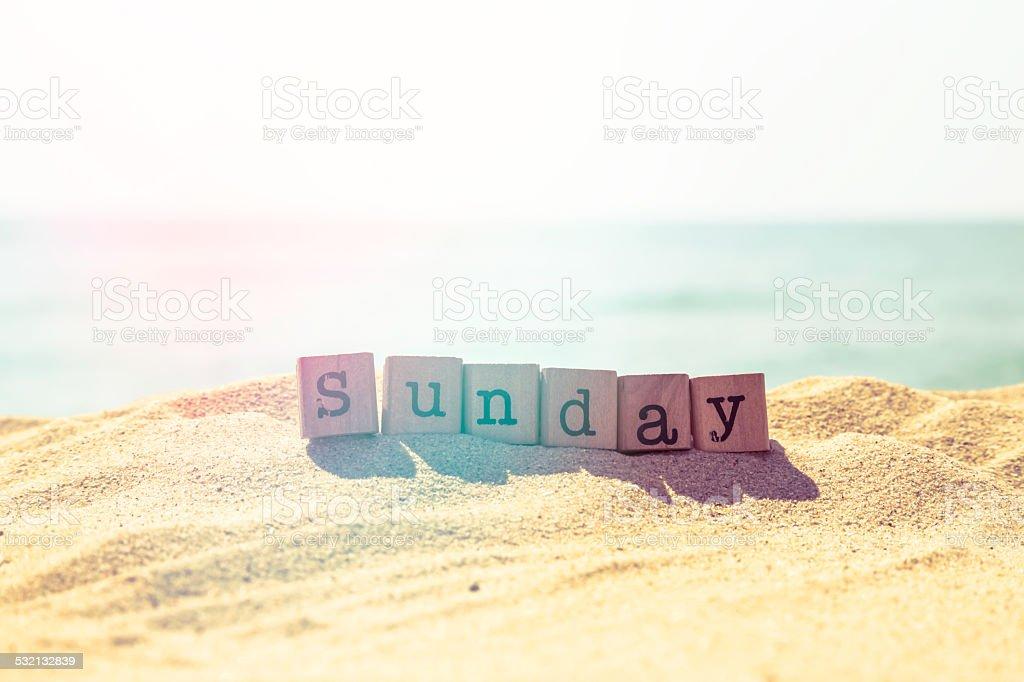 Sunday word on sea beach in retro style stock photo
