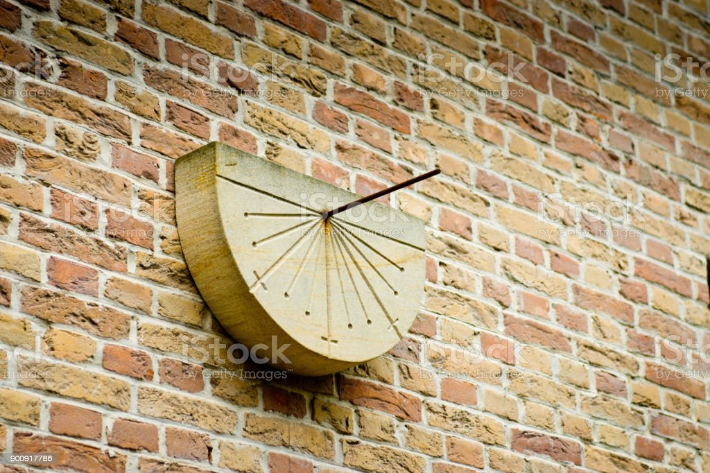 Sundial on a wall stock photo
