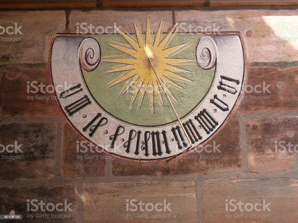 sundial on sandstone wall royalty-free stock photo